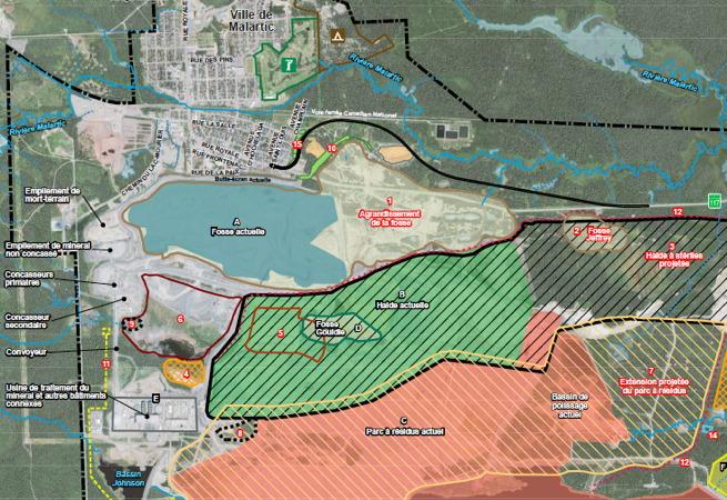 Capture-écran d'une carte de style « photo vue de l'espace » mais où les fosses et zones sont marquées en couleur. La fosse tout près de la ville ressemble à un grand lac.