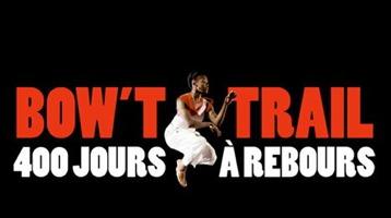 Logo : une femme noire, en robe blanche, saute dans les airs, ses bras dans une position difficile à décrire. 400 jours à rebours
