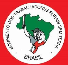 Logo du MST : dessin d'un homme et d'une femme. L'homme tient un flambeau. La femme est en rouge. Derrière le contour du pays en vert.