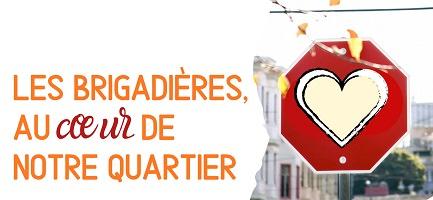 Affichette sur fond blanc : Les brigadières, au coeur de notre quartier. Un dessin de coeur est placé sur un panneau de signalisation (d'arrêt/stop).