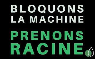 Affichette sur fond noir : « Bloquons la machine - Prenons racine ».