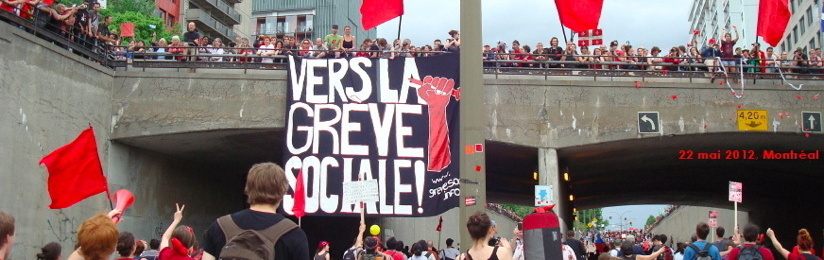 photo: des gens, à perte de vue, passant sous le viaduc Berri. Tout plein de gens sont sur le viaduc avec les drapeaux rouges de la lutte étudiante. Bannière géante suspendue: Vers la grève sociale. Derrière des tours d'habitation.