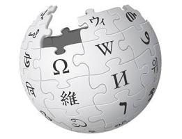 Logo de Wikipédia : globe gris pâle, composé de pièces de casse-tête, chacun avec une lettre de langues différentes (grec, japonais, etc.).