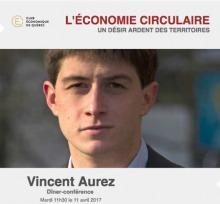 Affichette : photo de face de M. Aurez : jeune homme cheveux courts brun, regard intelligent. Logo du Club économique de Québec, soit un E jaune d'oré dans un cercle de la même couleur.