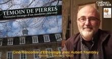 Affiche Internet composée de deux photos : une du couvent vu de bas en haut ; un portrait du réalisateur : souriant, chauve, lunettes subtiles, barbe blanche.